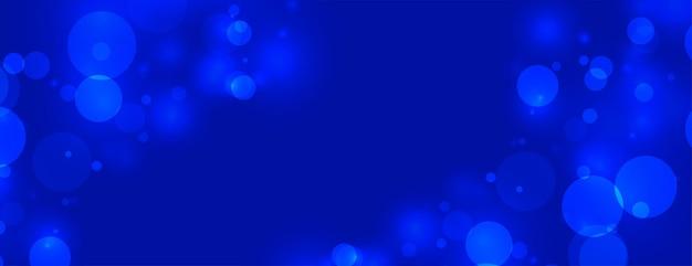 Fundo azul escuro com luzes bokeh