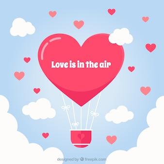 Fundo balão de ar quente com forma do coração Vetor grátis
