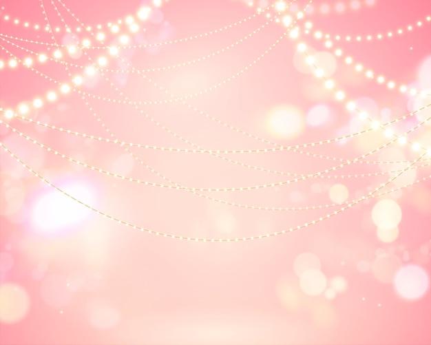 Fundo brilhante bokeh rosa com decoração de lâmpadas