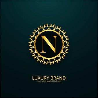 Fundo brilhante dourado do logotipo floral