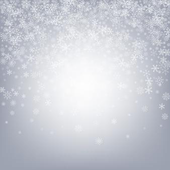 Fundo cinzento da neve. floco de neve.