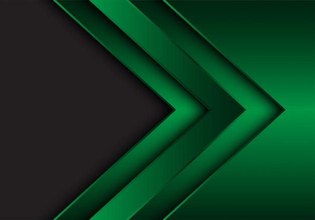Fundo cinzento do espaço vazio do sentido metálico verde da seta.