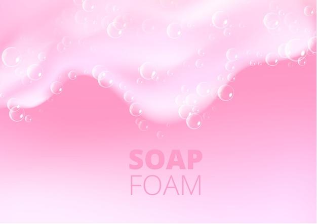 Fundo claro bonito com espuma rosa de banho. textura de bolhas de shampoo.