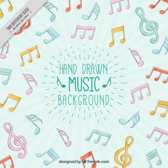 Fundo com a mão tirada colorido notas musicais