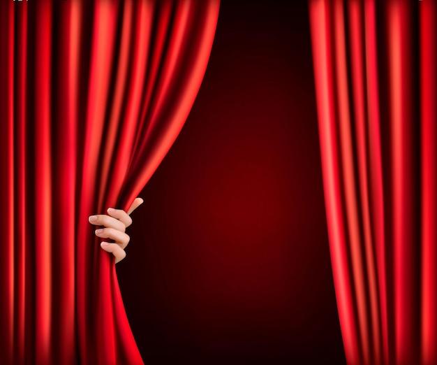 Fundo com cortina de veludo vermelho e mão.