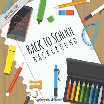 Fundo com material escolar em um notebook