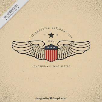 Fundo com um escudo e duas asas para o dia dos veteranos