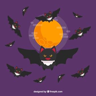 Fundo da lua com morcegos em design plano