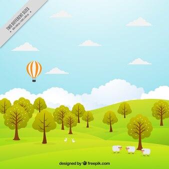 Fundo da paisagem do prado com árvores e balão de ar quente