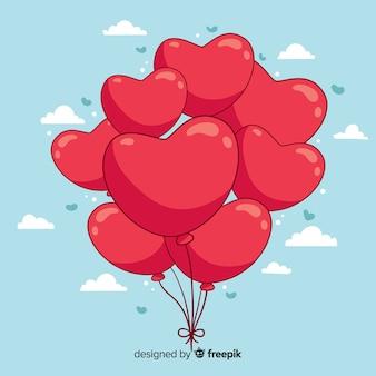 Fundo de balões de coração desenhado de mão
