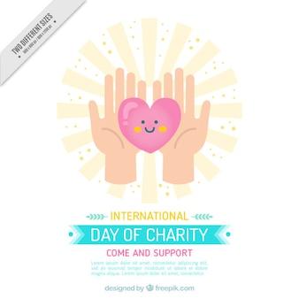 Fundo de caridade bonito das mãos segurando um coração bom