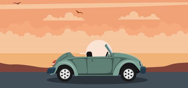 Fundo de carro clássico conversível em um pôr do sol na praia
