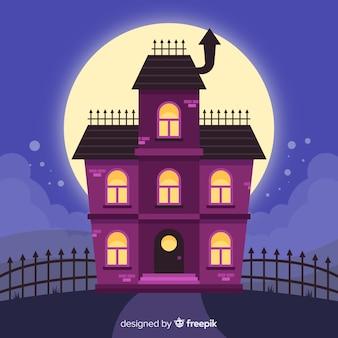 Fundo de casa assustador de halloween com lua cheia