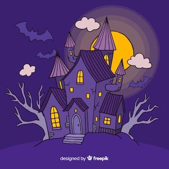 Fundo de casa de halloween com lua cheia na mão desenhada estilo