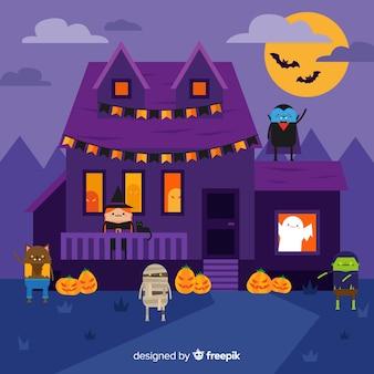 Fundo de casa de halloween com personagens assombradas