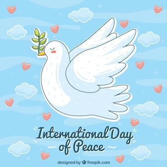 Fundo de céu com corações e mão desenhada pomba de paz