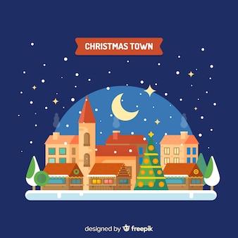 Fundo de cidade de bola de neve de natal