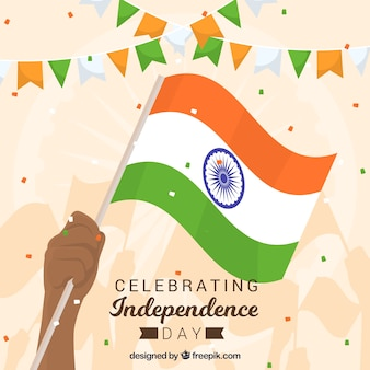 Fundo de dia da independência de India com a mão segurando a bandeira