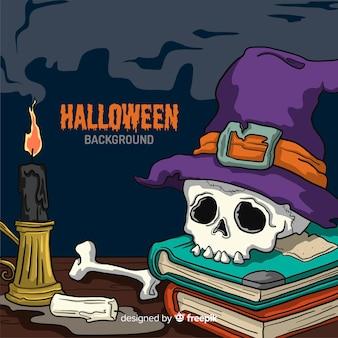 Fundo de dia das bruxas com caveira em livros