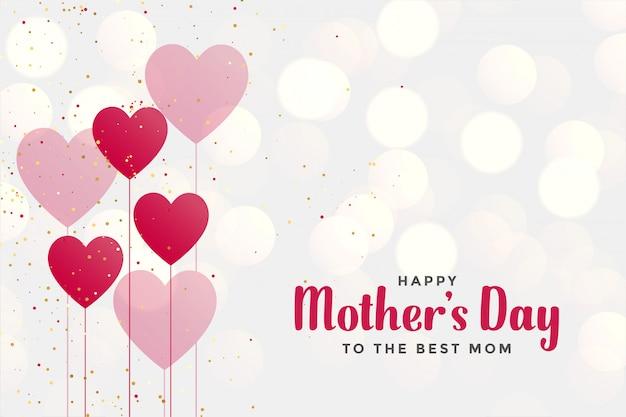 Fundo de dia das mães feliz com balões de coração Vetor grátis