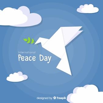 Fundo de dia de paz com origami moderno pomba