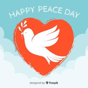 Fundo de dia de paz com pomba dentro de um coração