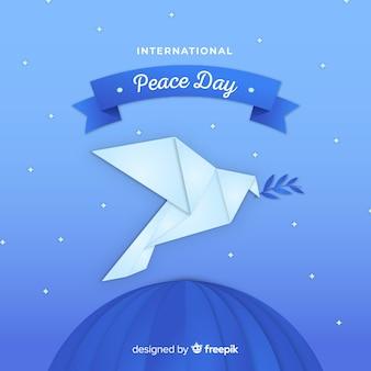 Fundo de dia de paz de origami com pomba