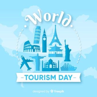 Fundo de dia de turismo com o mundo e monumentos em design plano