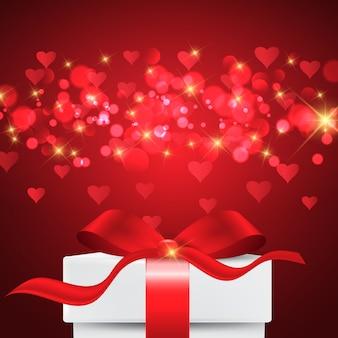Fundo de dia dos namorados com caixa de presente em luzes de bokeh