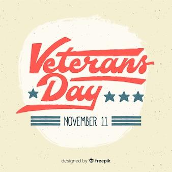 Fundo de dia dos veteranos com letras vermelhas e azuis