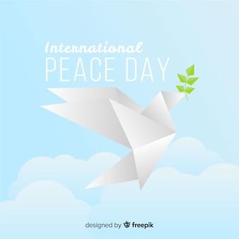 Fundo de dia moderno da paz com origami pomba