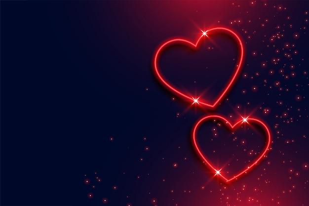 Fundo de dois corações vermelhos de néon com espaço de texto