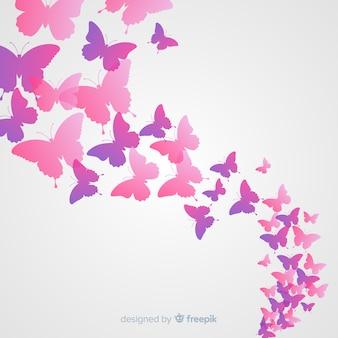 Fundo de enxame de silhueta de borboleta gradiente