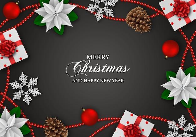 Fundo de feliz natal. flores de poinsétia branca, caixas de presente, flocos de neve e decorações de natal em fundo preto