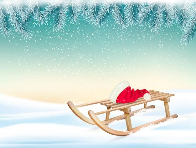 Fundo de férias de natal com chapéu de papai noel e um trenó