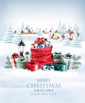 Fundo de férias de natal com presentes cheios de um saco vermelho e uma vila de inverno. .