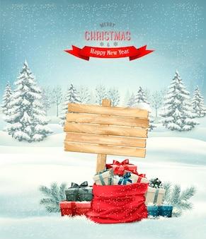 Fundo de férias de natal com um saco cheio de caixas de presente e uma placa de madeira