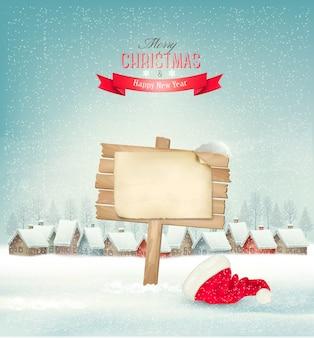 Fundo de férias de natal com uma vila e um sinal.