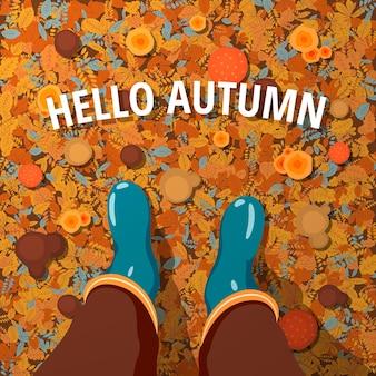 Fundo de folha caduca outono com a inscrição olá, outono e botas de borracha do homem