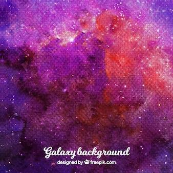 Fundo de galáxia de aquarela com tons avermelhados