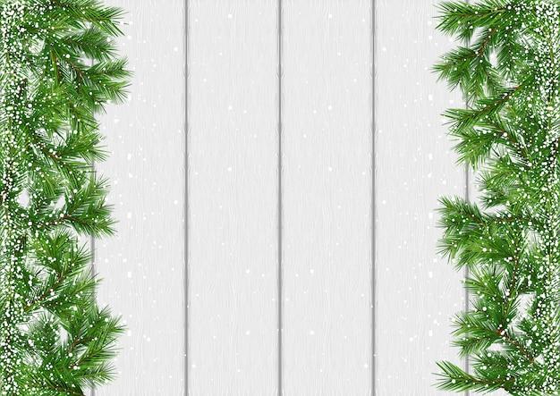 Fundo de galhos cobertos de neve de natal