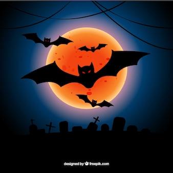 Fundo de halloween com lua laranja e morcegos
