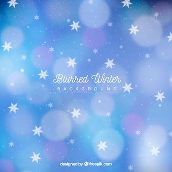 Fundo de inverno borrado com estrelas e flocos de neve