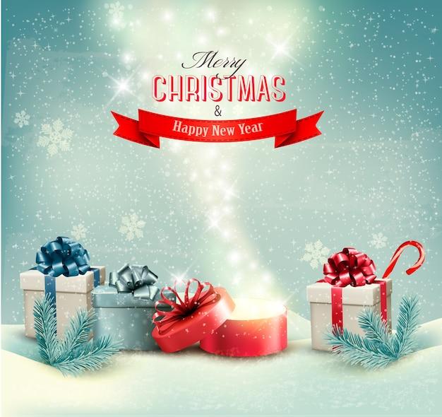 Fundo de inverno de natal com presentes e caixa mágica aberta