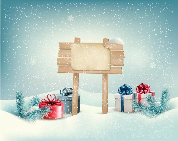 Fundo de inverno de natal com presentes e placa de madeira.