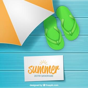 Fundo de madeira com flip-flops para o verão