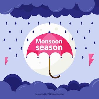Fundo de monção com guarda-chuva