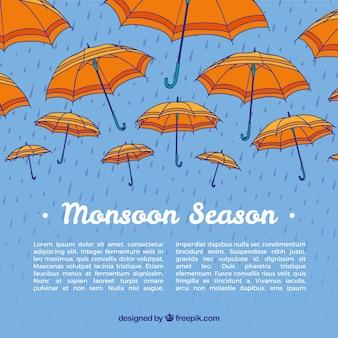 Fundo de monção com guarda-chuvas