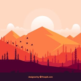 Fundo de montanhas ao pôr do sol