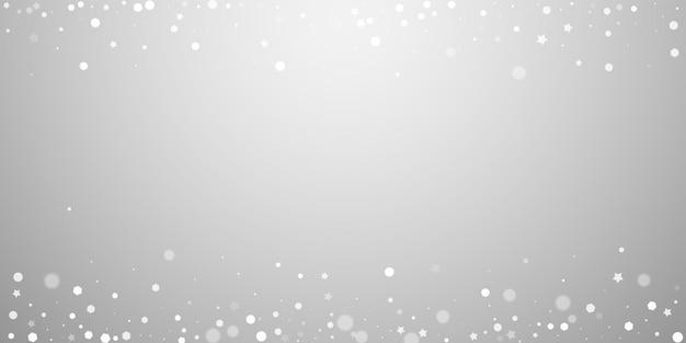 Fundo de natal aleatório de estrelas mágicas. flocos de neve voando sutis e estrelas sobre fundo cinza claro. divertido modelo de sobreposição de floco de neve de prata. ilustração vetorial notável.